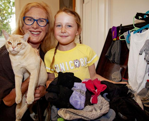 Mette Kristiansen and Harriet Kristiansen-Benge, 6, pictured with Jasper and the items he has...