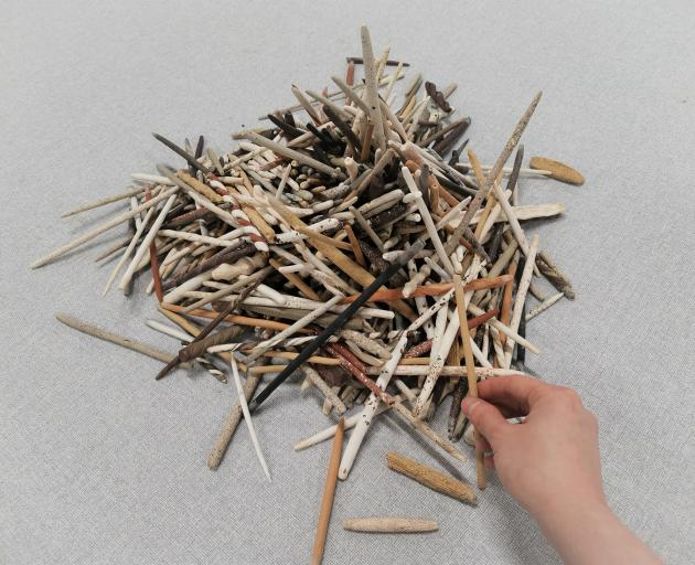 This is Us, Eva Ding's winning ceramics work. The ceramic sticks can be grouped in many different...