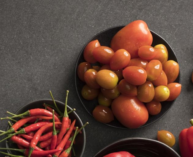 The chili and the tomato share some of the same DNA because they are long lost cousins. Photo:...