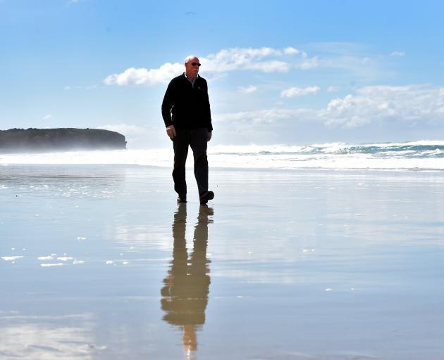 Emergency Management Otago group controller Chris Hawker walks on St Kilda Beach. Photo: Peter...