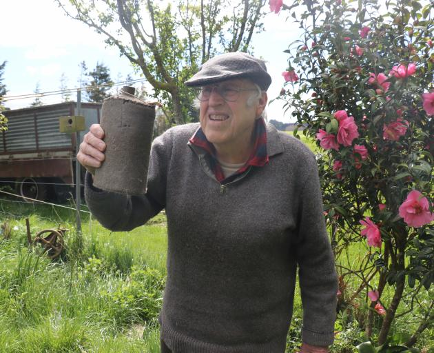 Balclutha resident Mel Tapp holds an old water bottle he took from the Milton Town Hall more than...