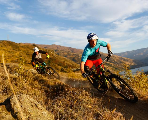 Jason Thomsen (left) and Jimmy Pollard ride some mountain-bike trails in Clyde, similar to the...