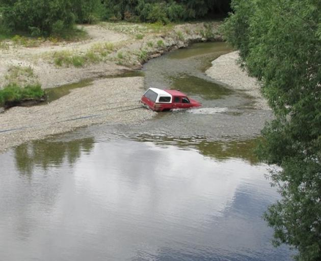 Concerns have been raised about the safety of swimmers in the Manuherikia River after a four-wheel-drive became stuck in the riverbed recently. PHOTO: SUPPLIED