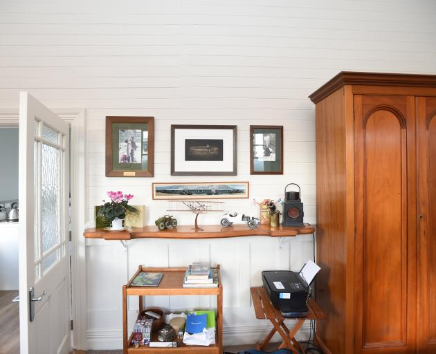 The kauri shelf belonged to Mrs Barta's parents and the cupboard beside it is thought to have...