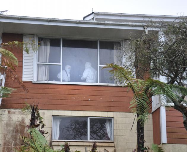 Police officers search the home of a Hokitika man charged with killing a 10-month-old baby. PHOTO...