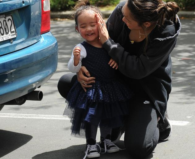 Ashley Papara  embraces her daughter Tilly after she was rescued by firefighters from a car...