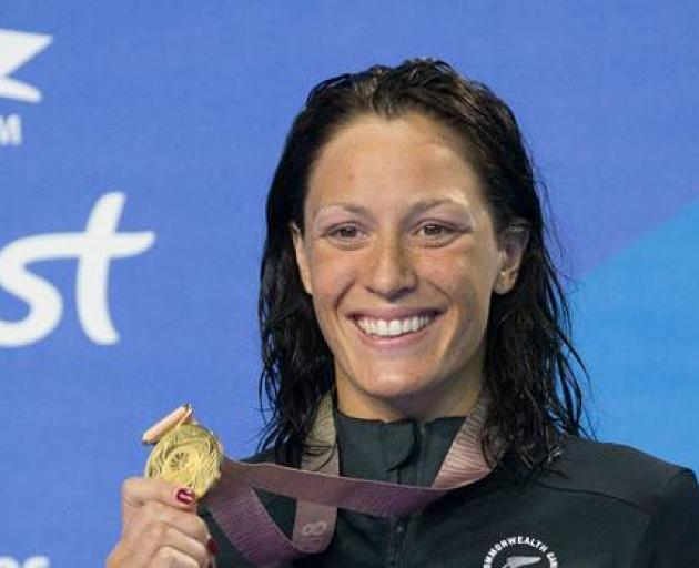 New Zealand's Sophie Pascoe celebrates with a gold medal won at the Commonwealth Games. Photo: NZ...