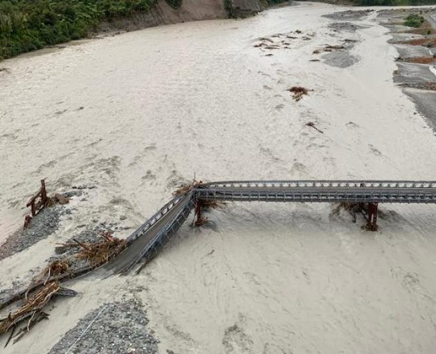 Raging floodwaters destroyed the Waiho Bridge on SH6 in March. Photo: DOC