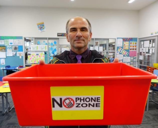 East Otago High School Deputy Principal Keith Fleury. Even teachers' phones go in the box Photo:...