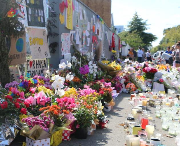 Tributes and flowers left outside Al Noor Mosque in Christchurch after the attacks. Photo: RNZ