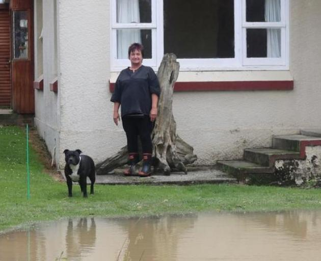 Near the Wyndham bridge, Sue Campbell's driveway has been ripped up by the force of the water...