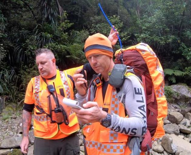 Dwayne Lohmann and a LandSAR team mate during the search for the missing trampers. Photo: Dwayne...