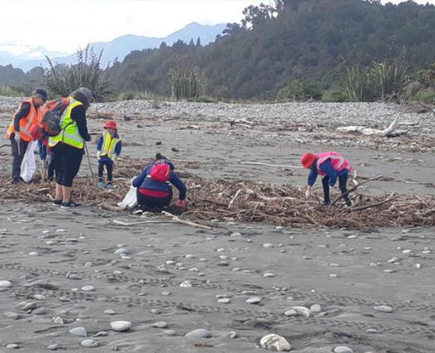 South Westland Coastal Cleanup volunteers clear litter and detritus swept into rivers and beaches...
