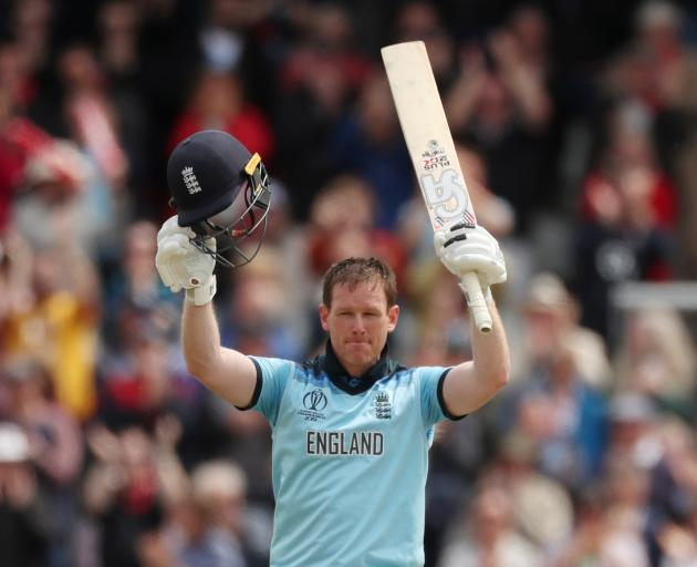 Eoin Morgan celebrates his century before going on to smash a career best 148. Photo: Action Images via Reuters