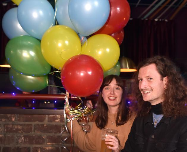 Ariane Bray and Dylan McCutheon-Peat, both of Dunedin, at Woof during the election party Saturday...