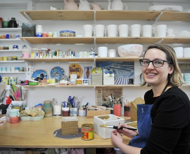 Elise Johnston works on one of her ''boxes'' in her home studio.