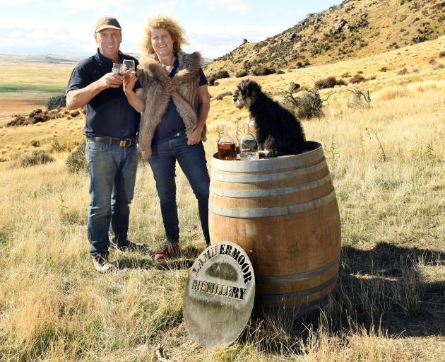John and Susie Elliot and dog Truffles with their farm-brewed spirits on Lammermoor Station....