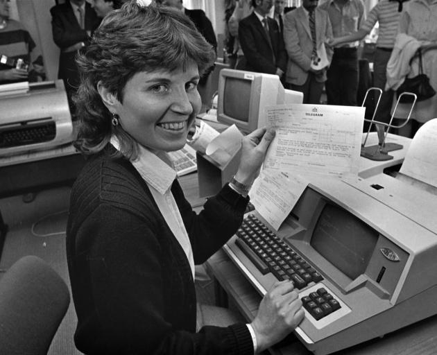 Dunedin telegraph operator, Esme Cullen, prepares to send the final  telegram from Dunedin, when...