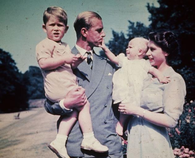Princess Elizabeth with Prince Philip and their two eldest children Prince Charles and Princess...
