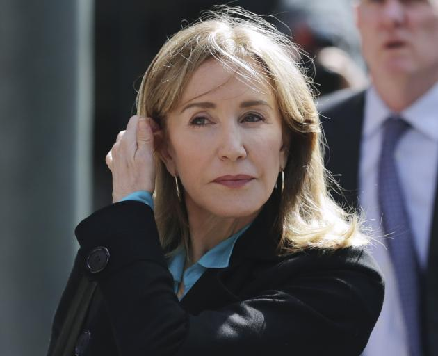 Felicity Huffman was accused of paying to rig her daughter's SAT score. Photo: AP