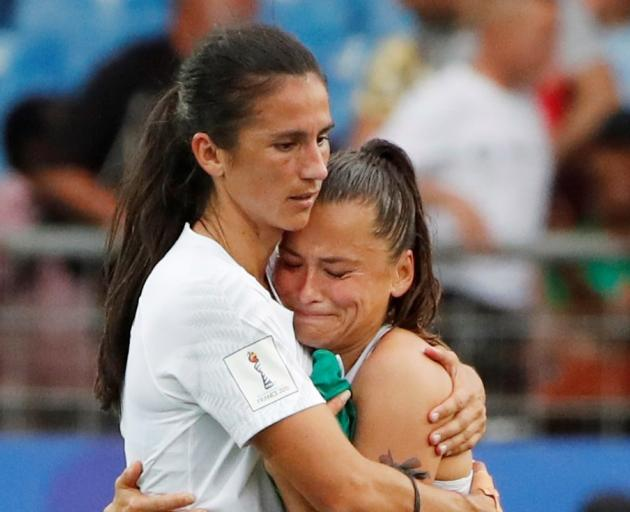 Abby Erceg consoles Ali Riley after the match in Montpellier. Photo: Reuters