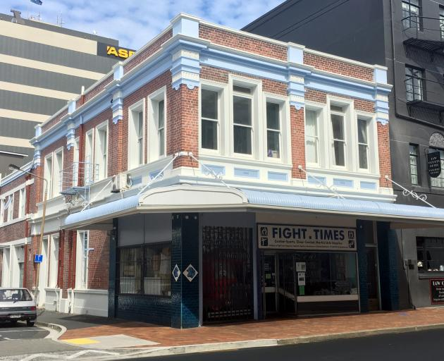 Developers Geoff and Trish Todd have retained the original blue butcher's tiles at the entrance of the Fight Times building while upgrading the building's original facade. Photo: Otago Daily Times