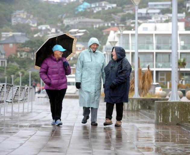 Regular walkers (from left) Marilyn Yates (66), Jo Springett (76) and Kathleen  West (70)  dress for the conditions at St Clair Esplanade, Dunedin, earlier this  week. ''We usually walk for an hour, sometimes longer,'' Mrs Springett says.  ''W