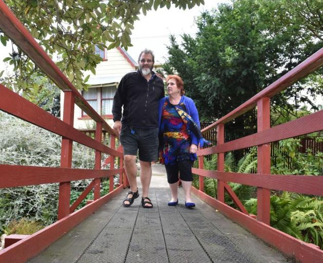 Bruce and Joy Hall's plans are on hold after last year's flood, which damaged their bridge, land and  garage, was followed by an insurance nightmare.  Photo by Gregor Richardson