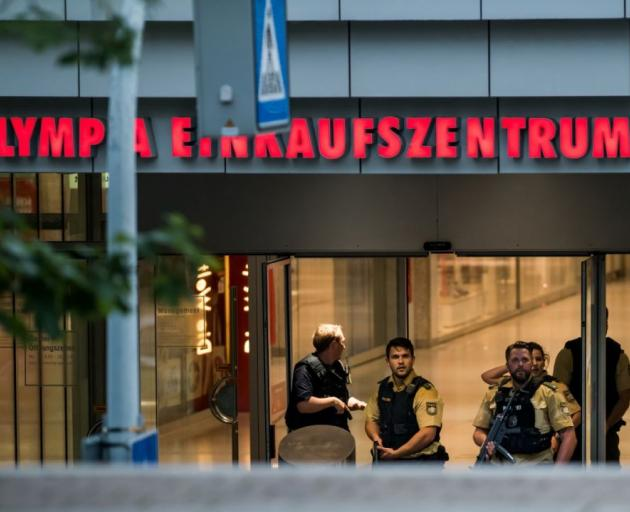 Police officers respond to a shooting at the Olympia Einkaufzentrum (OEZ) at July 22, 2016 in Munich, Germany. According to reports, several people have been killed and an unknown number injured in a shooting at a shopping centre in the north-western Moos
