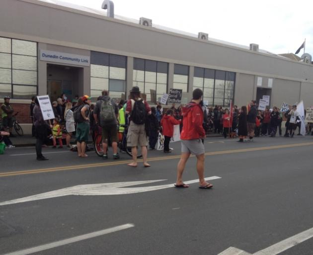 About 150 people gathered outside Work and Income in Dunedin to protest proposed welfare reforms. Photo by Craig Baxter.