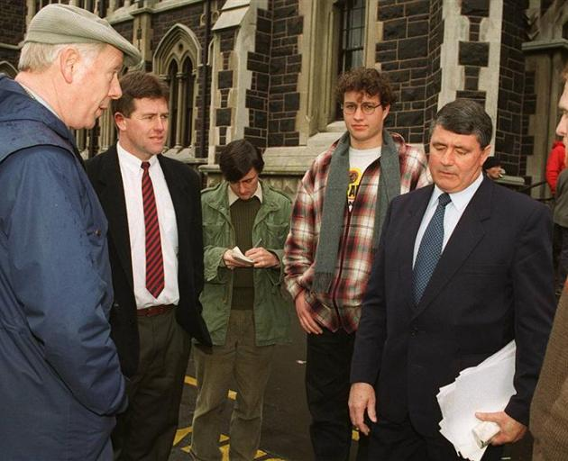 The Otago University proctor, Ron Chambers (left), warns Alliance leader Jim Anderton (second from right) about potential trespass. Assistant proctor Scott McNaughton is second from left, beside Michael Gibson, chief news reporter for Critic, and student