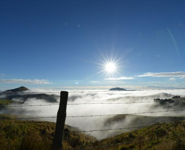 Harbour Cone (left) and Mt Charles poke above  fog that rolled up  Otago Harbour and over low-lying parts of the Otago Peninsula yesterday  morning. Photo by Stephen Jaquiery.