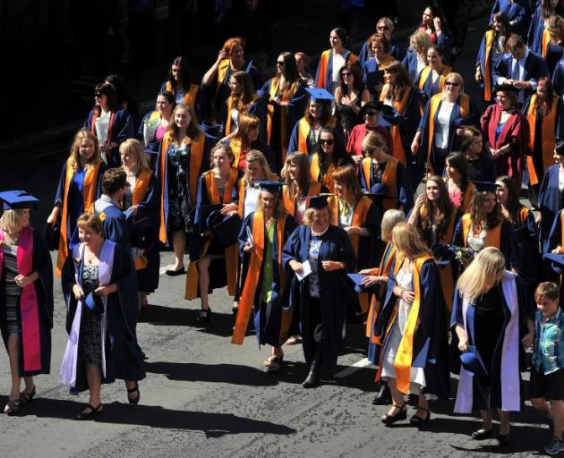 Otago Polytechnic graduands parade through central Dunedin yesterday before attending a 3pm graduation ceremony at the Dunedin Town Hall. Photo by Craig Baxter.