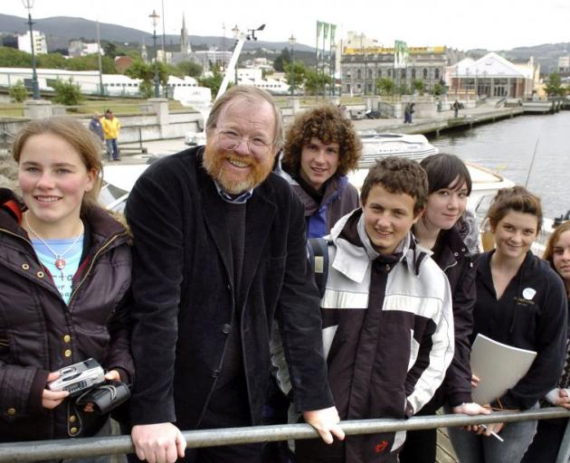 Bill Bryson in Dunedin in 2007 with several Dunedin high school pupils after the author had survived a ''bombing'' by a seagull. Photo by Stephen Jaquiery.