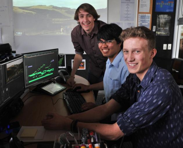 John McGlashan College pupils (from left) Paul Blondell, Koon Chakhatrakan and Liam Tompkins (all 17) put the final edits in their fundraising feature film Delinquent. Photo by Linda Robertson.