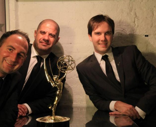 In New York yesterday with the Sports Emmy for the outstanding new approaches for sports event coverage are (from left) Cannonball Software mobile app developer Stu Sharpe, Moving Pixel creative director Nathan Martin and Animation Research Ltd sailing op