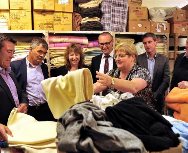 Being shown donations for refugees by Red Cross southern humanitarian services manager Sue Price (centre) are (from left) National MP Michael Woodhouse, Mayor Dave Cull, Labour MPs Clare Curran and David Clark, Mercy Hospital chief executive and Red Cross