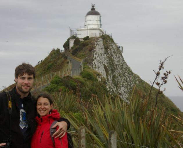 Jens Hoffmann and Carmen Fluhr, from Germany, gave the unsealed road to Nugget Point mixed reviews yesterday. While he liked it, she found it ''scary''. Photo by Hamish MacLean.
