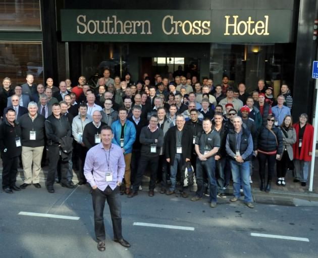 Single Width Users Group New Zealand chairman Dan Blackbourn steps out in  Dunedin with  other printing conference delegates  yesterday. Photo by Gregor Richardson