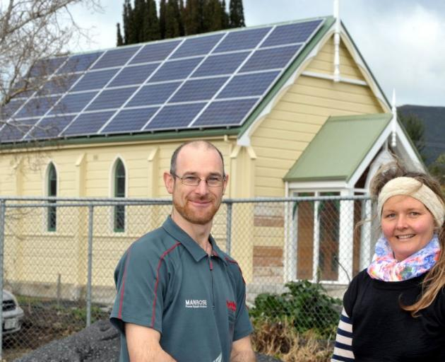 James Hardistry and Sally Brown admire the new solar panels which are helping to power Blueskin Nurseries and Cafe. Photo by Gregor Richardson.