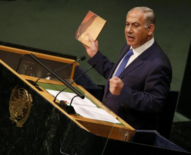 """Benjamin Netanyahu with the latest book by Iranian Supreme Leader Ayatollah Ali Khamenei that he said was a """"400-page screed detailing his plan to destroy the state of Israel.""""  Photo: Reuters"""