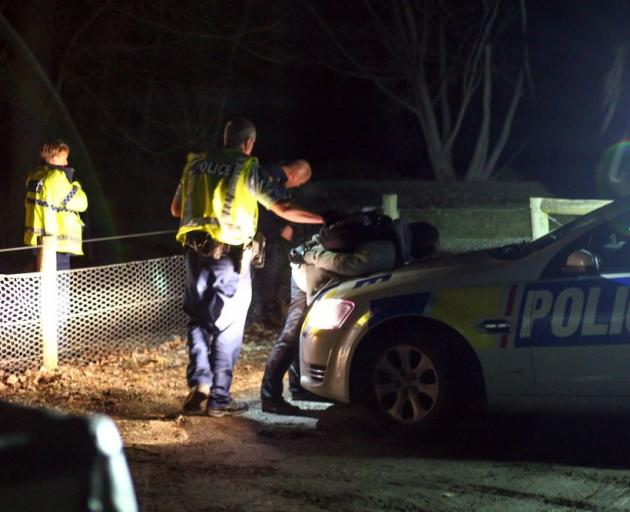 A man is detained after a police chase in the Queenstown area last night. Photo by Blair Pattinson