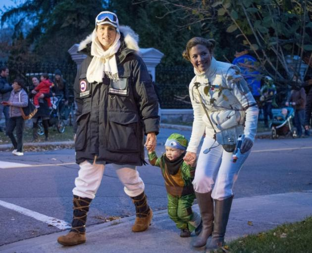 Canadian Prime Minister-designate Justin Trudeau, dressed as Han Solo, and his wife Sophie Gregoire with their son Hadrien, while trick-or-treating on Halloween. Photo: Reuters