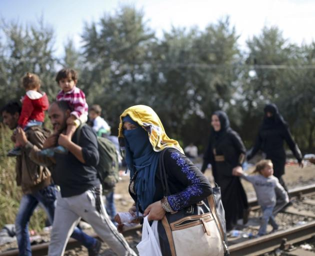 Migrants making the trek fromSerbiaat the border nearRoszke in Hungary. Photo: Reuters