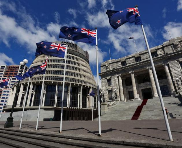 New Zealand flags fly in front of The Beehive and Parliament House. Photo: Getty Images