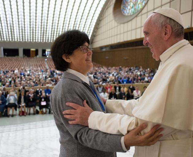 Pope Francis is greeted by Sister Carmen Sammut, a Missionary Sister of Our Lady of Africa, during an audience at the Vatican this week. Photo: Osservatore Romano/Handout via Reuters
