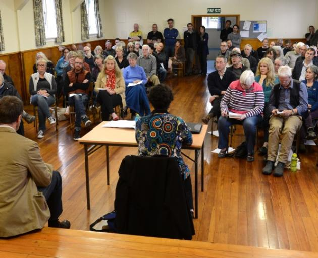 Blueskin Energy project manager Scott Willis (left) and meeting adjudicator Suzanne Robbins (centre) listen to a question  during a community meeting at the Warrington Memorial Hall last night about Blueskin Energy's proposed wind farm on Porteous Hill. P