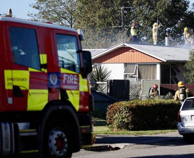 Fire crews battle the house fire in Kaiapoi. Photo: George Heard