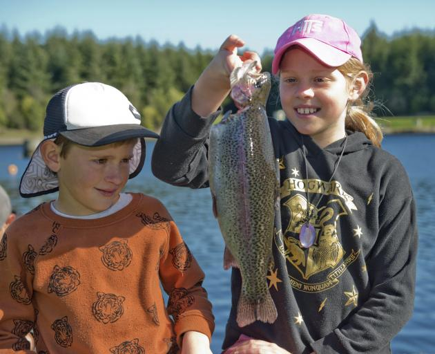 Daniel (7) and Emma (9) Collins, of Dunedin, show off the dinner they caught at the Southern...