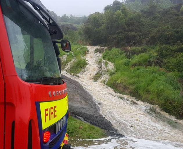 A torrent of water comes down in Ravensbourne. Photo: George Block